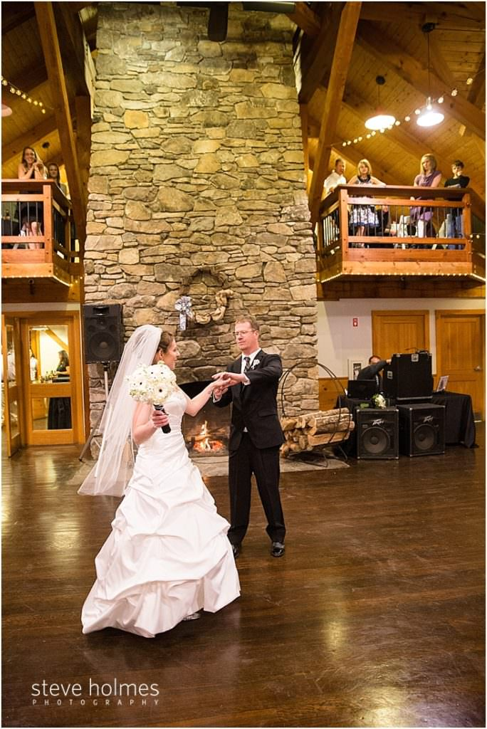 40_bride-groom-first-dance-by-stone-fireplace