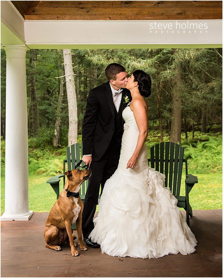 45_bride-and-groom-kiss-while-their-dog-looks-up-at-them