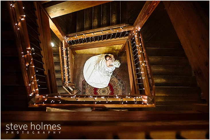 48_looking-down-at-bride-through-staircase-as-she-looks-up