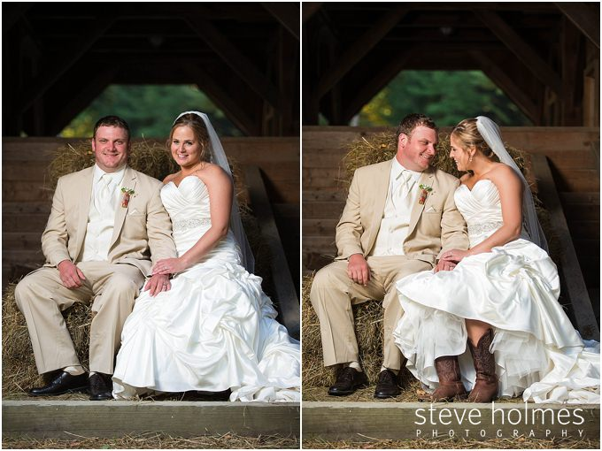 64_bride-groom-sit-hay-bales