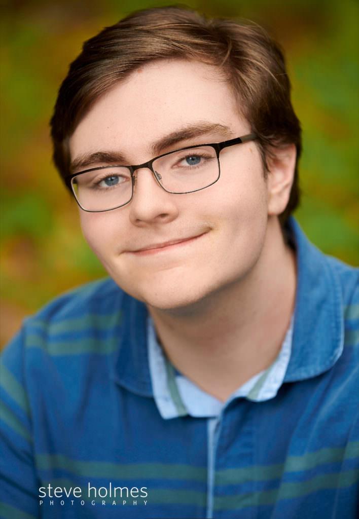 teen boy poses for outdoor senior portrait