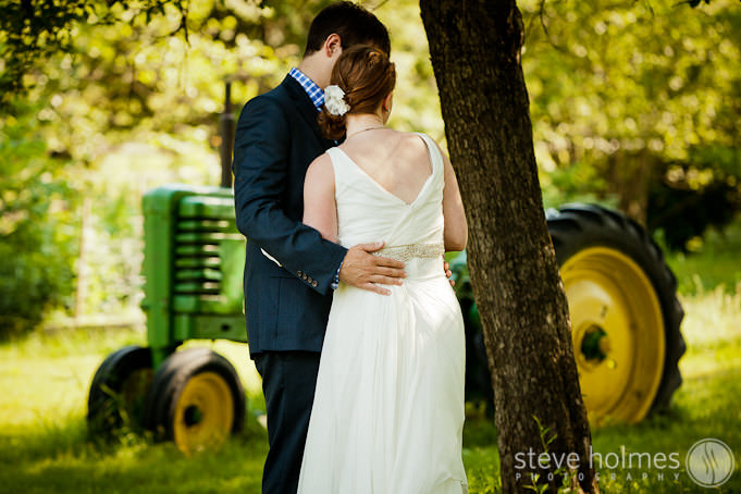 Stonewall Farm Wedding portrait under tree next to tractor