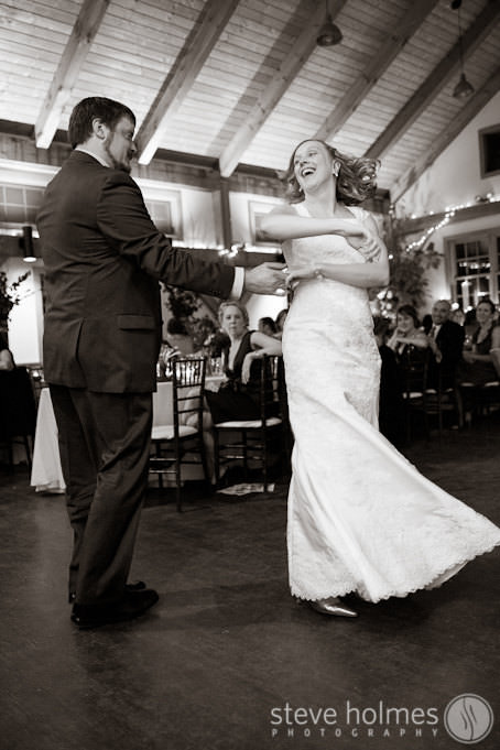 Groom twirls bride during first dance at Stonewall Farm
