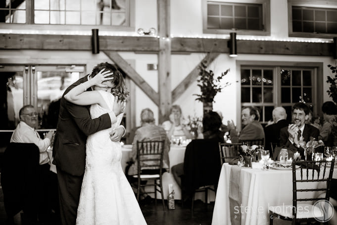Groom and Bride hold each other close in sweet first dance