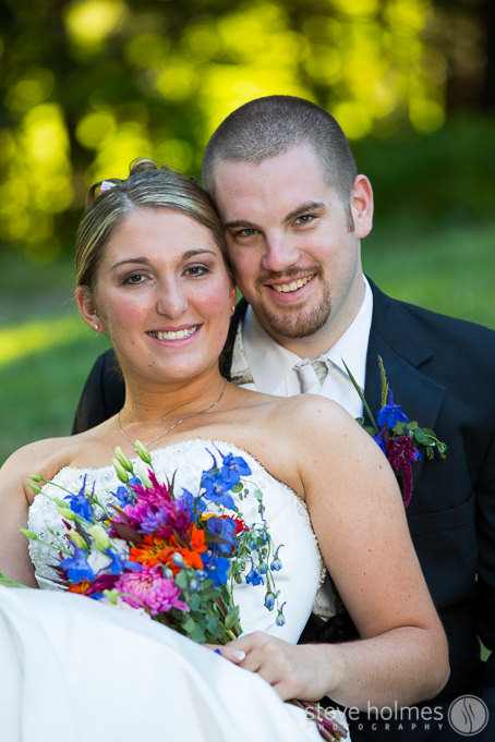 Bride and Groom pose for outdoor wedding portrait