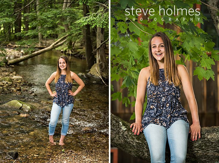 07_Teen in flowered blouse and jeans stands in a flowing stream for senior portrait.jpg