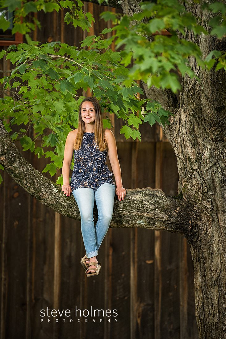 08_Brunette teen sits high on a limb of a giant maple tree.jpg