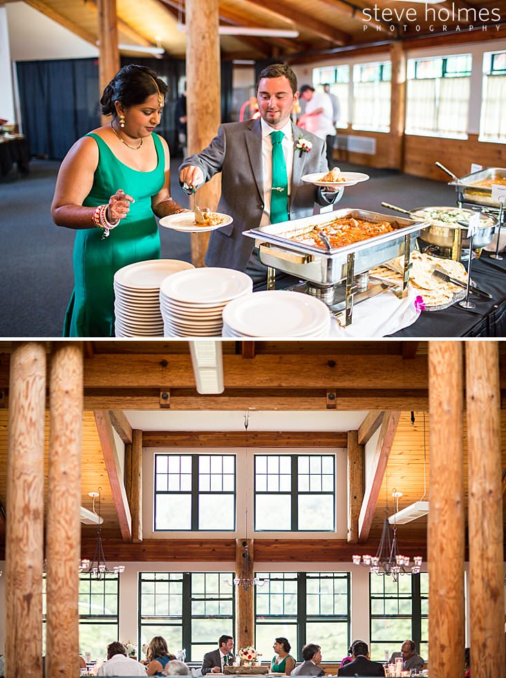 Groom serves bride from buffet