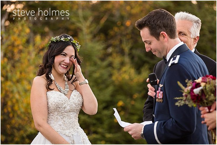 29_bride-wipes-away-tears-while-groom-reads-vows