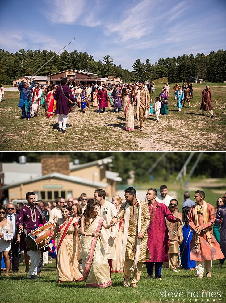 Wide shot of wedding guests dancing in processional
