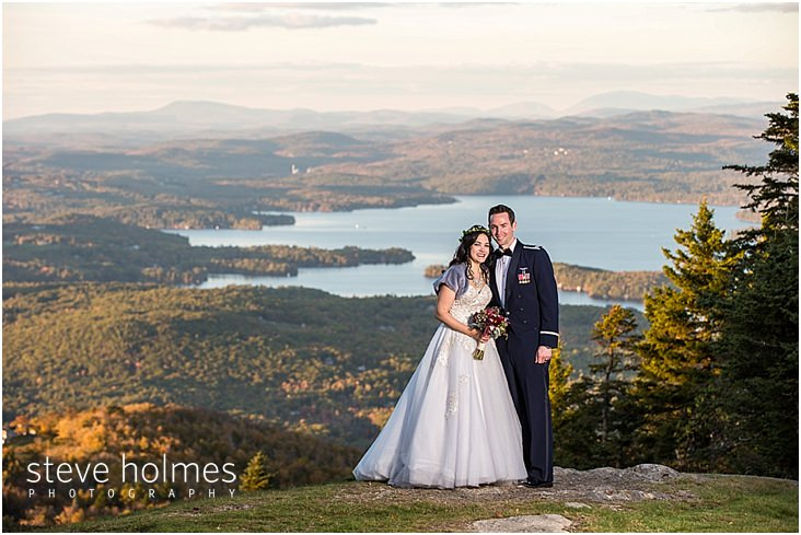 35_smiling-bride-groom-with-mountains-and-lake-behind-them