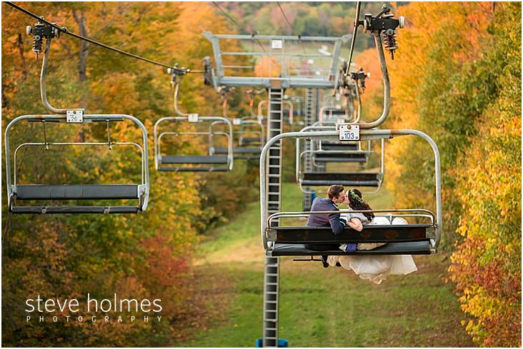 39_bride-groom-kiss-while-riding-down-chairlift