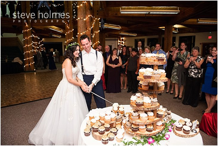54_bride-groom-cut-cupcake-with-sword