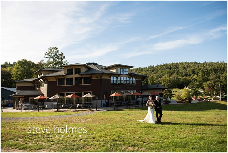 Bride walks to ceremony at Mount Sunapee Lodge