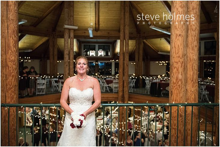 Bride tosses bouquet over balcony at Mount Sunapee Resort