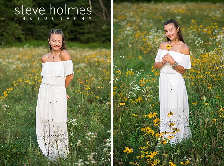 05_Teen with white dress poses smiling with arms crossed behind her in field of wildflowers.jpg