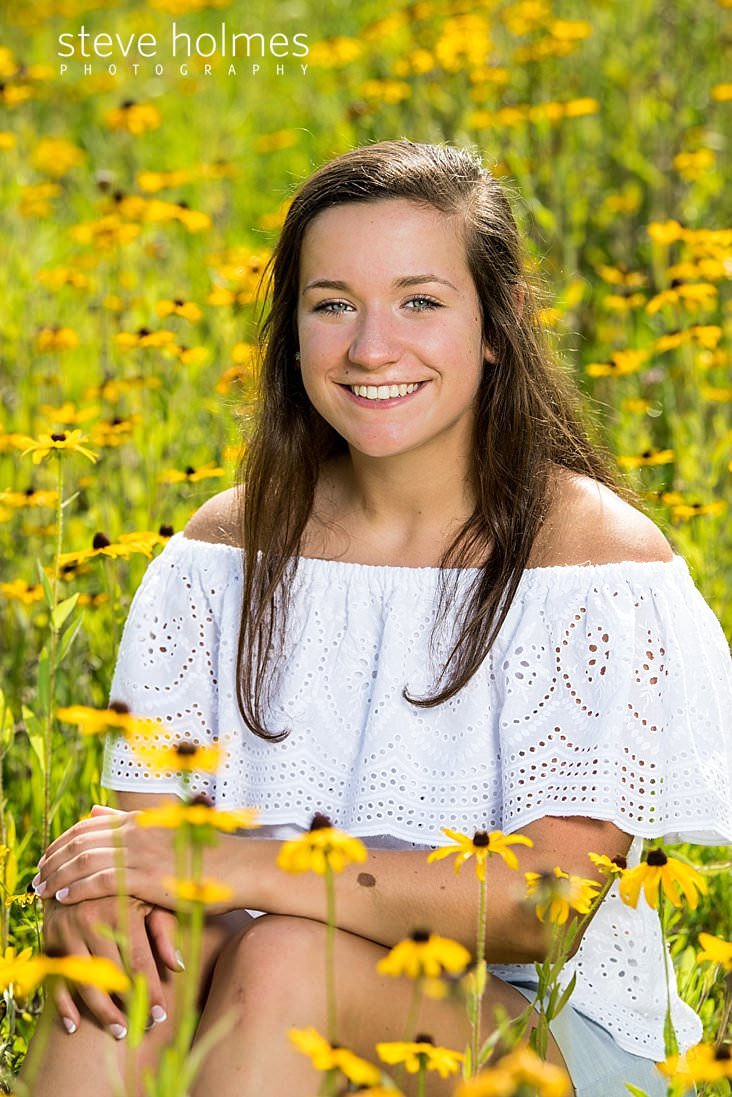 12_Close up senior portrait of teen in field of flowers.jpg