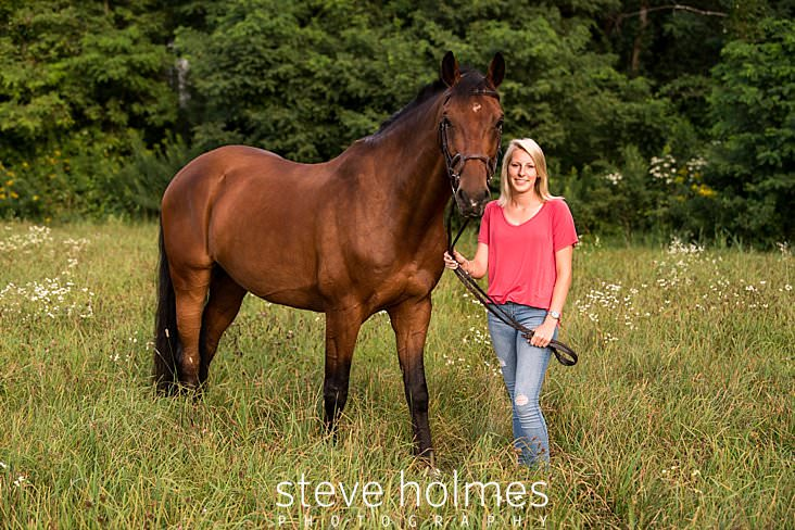 09_Blonde teen stands with her horse in summer field.jpg