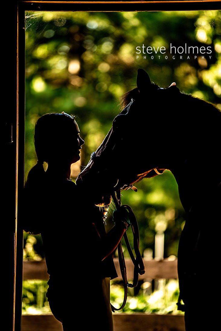 09_Silhouette of girl with her horse in barn door.jpg