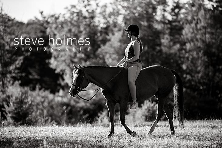 13_Black and white portrait of teen riding bareback in field.jpg