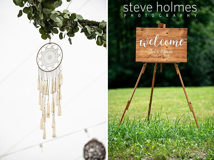 05_Dream catchers hang from eucalyptus garlands in tent for wedding reception.jpg