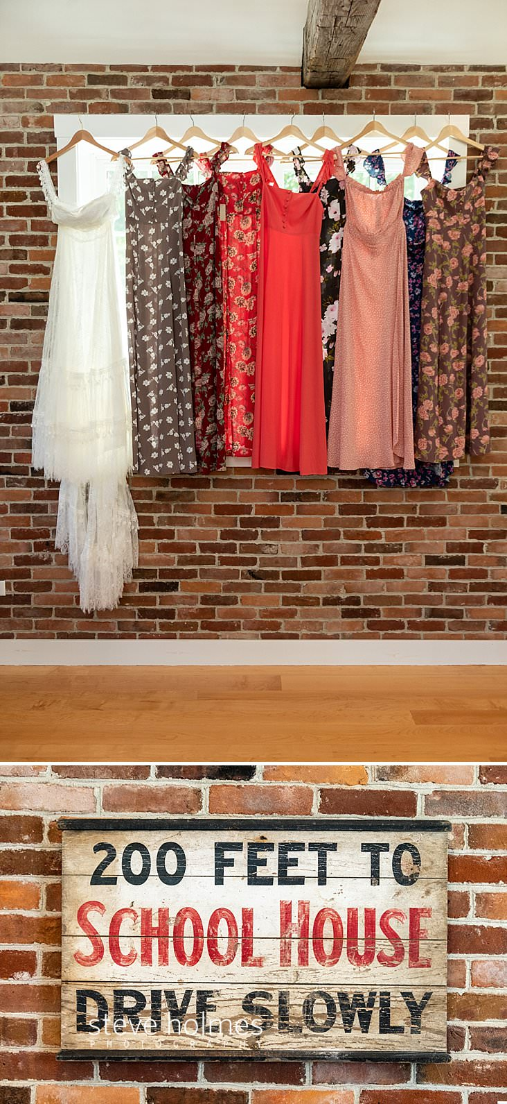 08_Bridal gown and bridesmaids dresses hang in window surrounded by brick wall.jpg