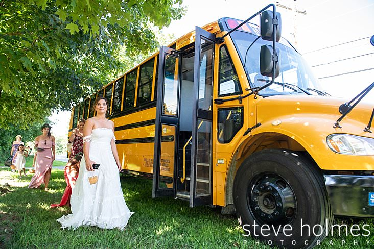 27_Bride walks onto school bus to go to ceremony.jpg
