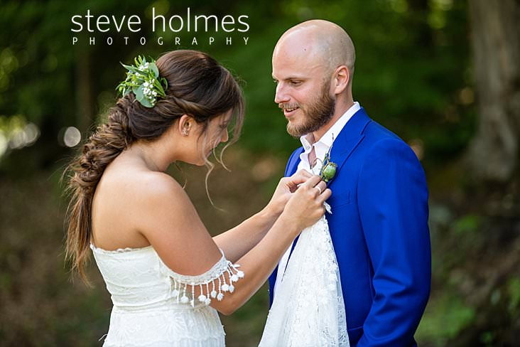 33_Bride adjusts groom's boutonniere.jpg