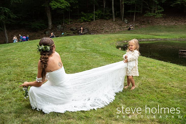 67_Flower girl plays with the train on the bride's dress_.jpg