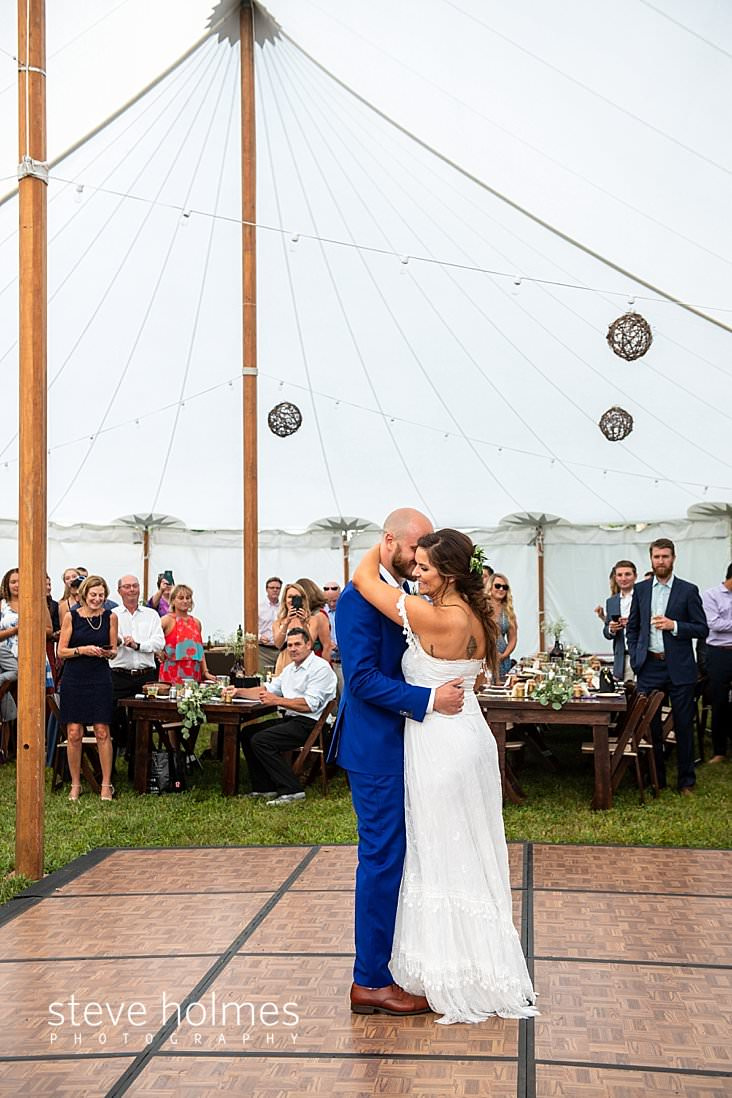 75_Bride and groom share first dance under tent.jpg