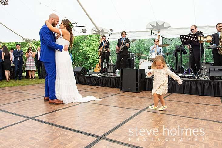 76_Flower girl sneaks into first dance to play.jpg