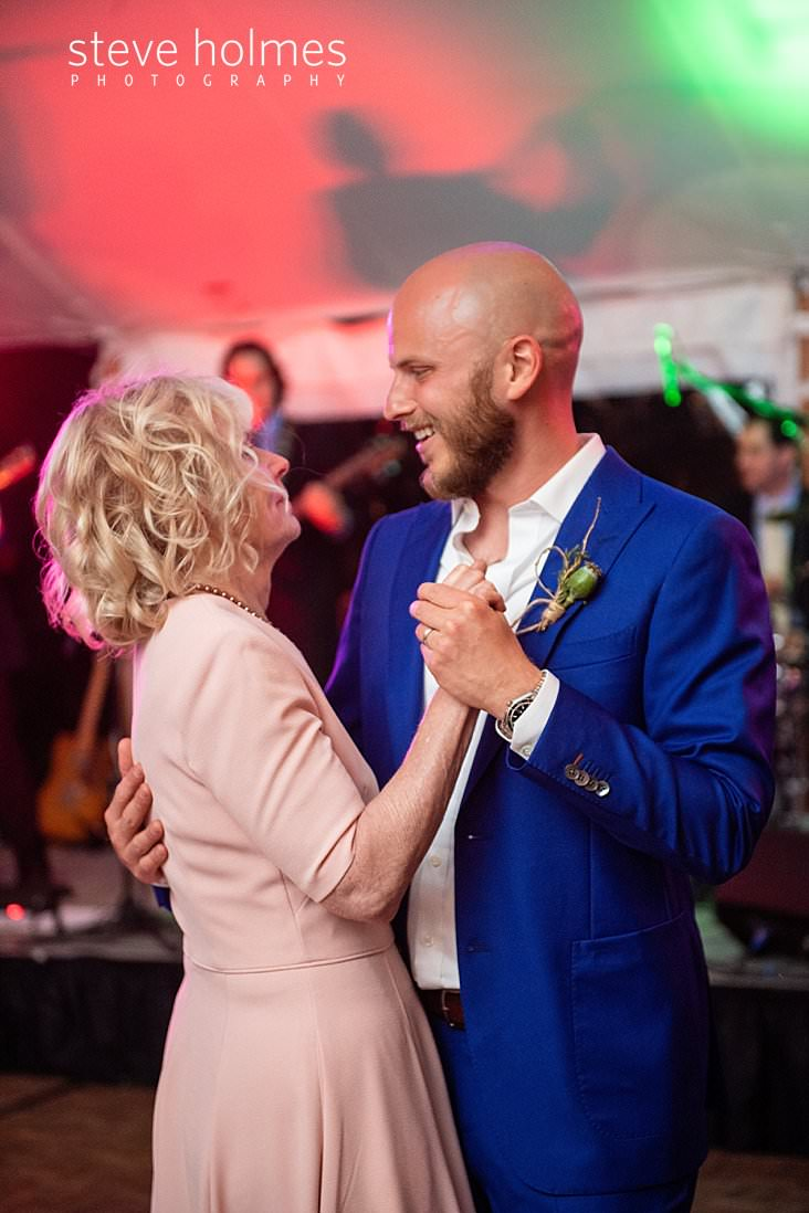 86_Groom dances with his mother under tent_.jpg