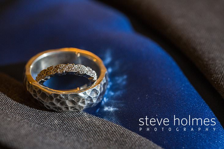 03_Wedding rings stacked together on suit.jpg