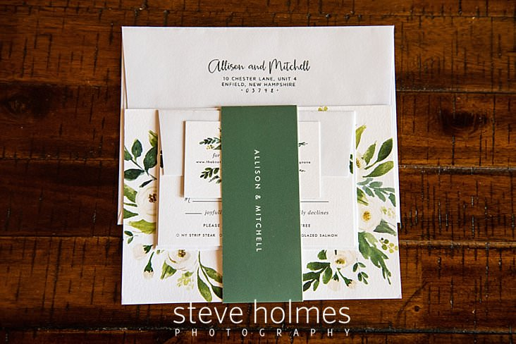 04_Wedding stationary with white flowers and greenery_.jpg