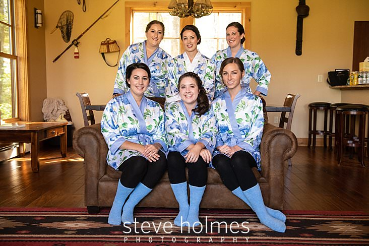 05_Bride poses with bridesmaids in blue floral robes.jpg