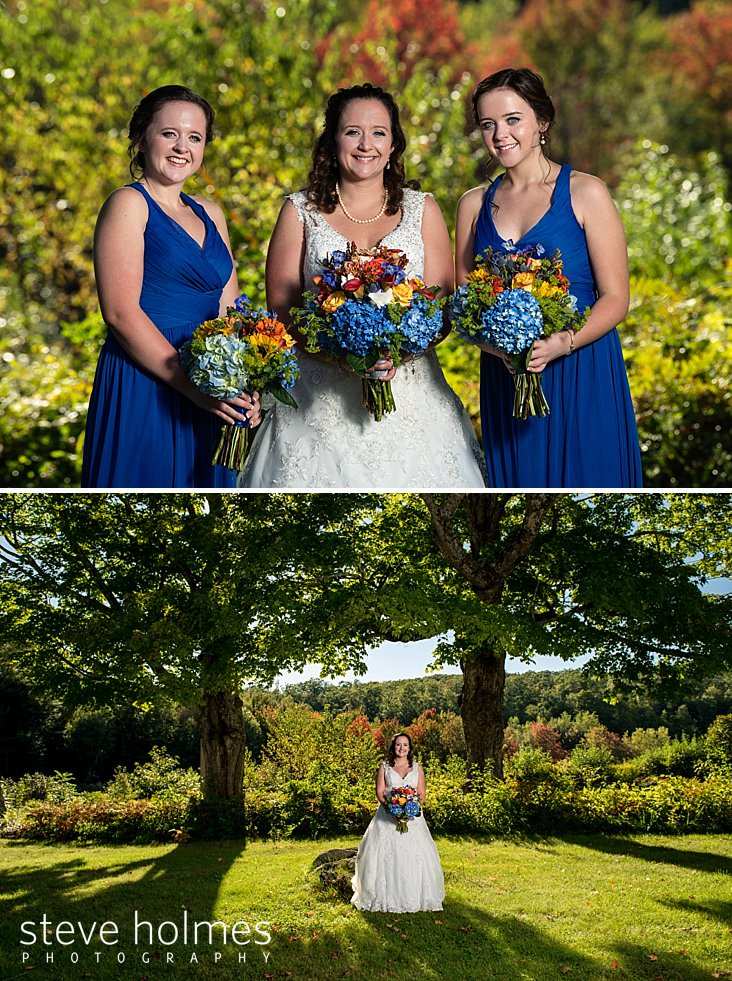 17_Bride flanked by her twin sister bridesmaids in blue holding their bouquets.jpg
