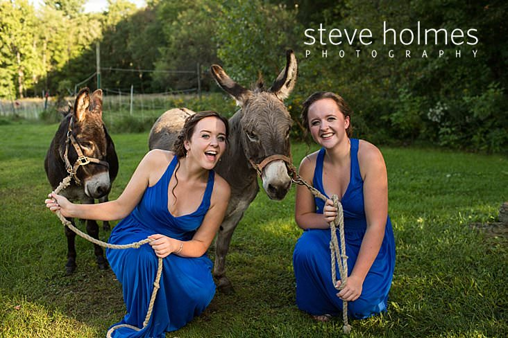 20_Twin bridesmaids in blue hold the leads of miniature donkeys.jpg