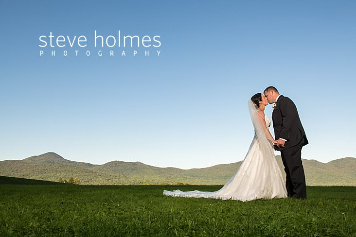 24_Bride and groom kiss with Green Mountain range in background.jpg