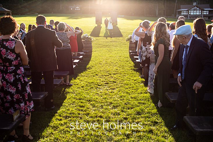 32_Guests stand as bride and father walk down isle.jpg