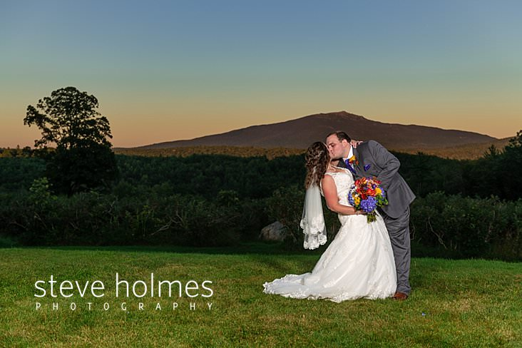 54_Bride and groom kiss at sunset in front of Mt. Monadnock.jpg