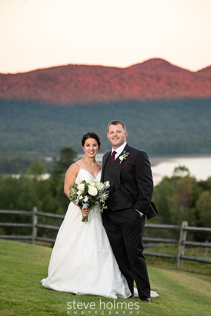 55_Bride and groom pose before the sunset on the Green Mountain range.jpg