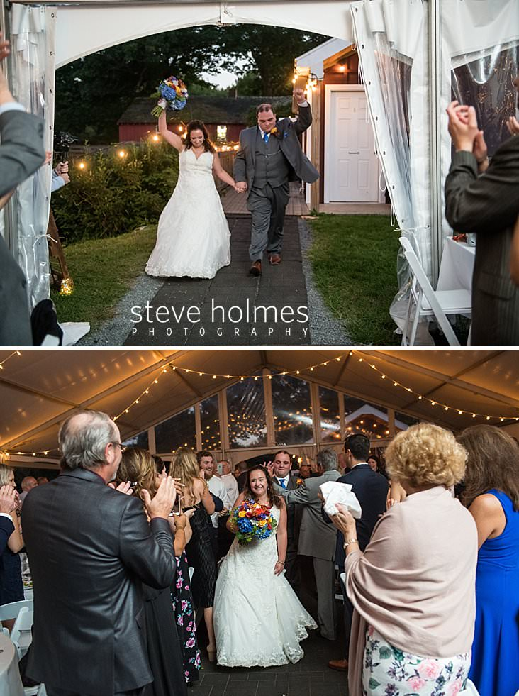 61_Bride and groom enter tent with fists raised.jpg