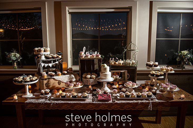 62_Dessert table with assorted cupcakes and cake at wedding reception.jpg
