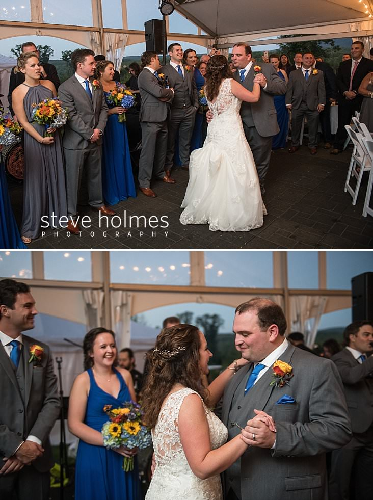 63_Bride and groom have first dance under tent while bridal party looks on.jpg