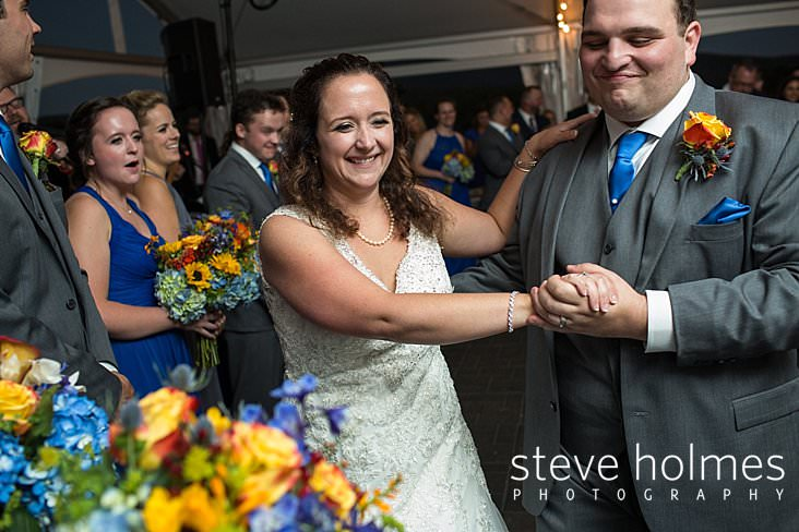 65_Bride and groom smile during first dance.jpg