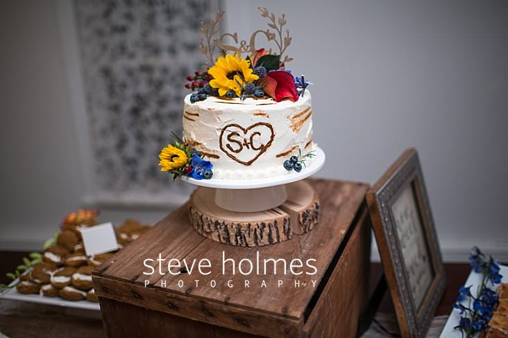 70_Birch bark cake topped with autumn flowers at wedding reception.jpg