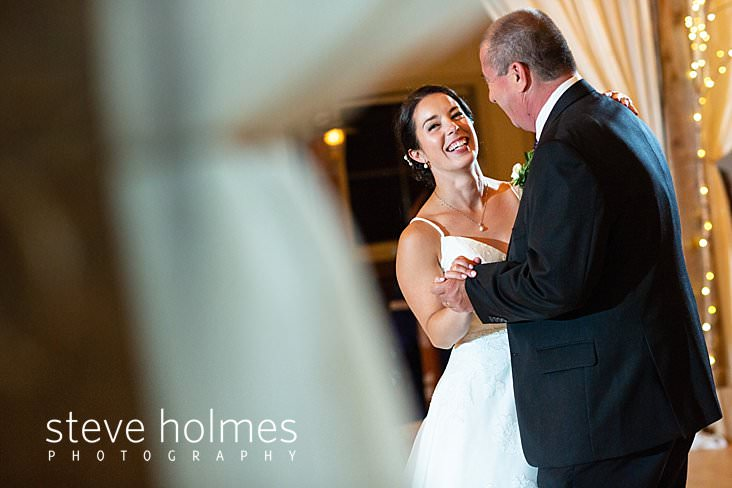 72_Portrait of smiling bride dancing with her father.jpg