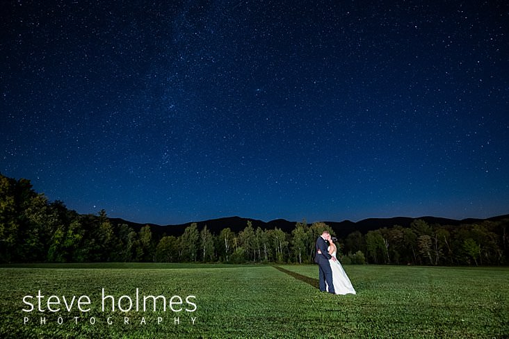 75_Bride and groom kiss under starry skies at The Mountain Top Inn and Resort.jpg