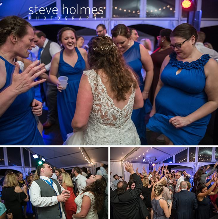 76_Bride dances with her bridesmaids in blue.jpg