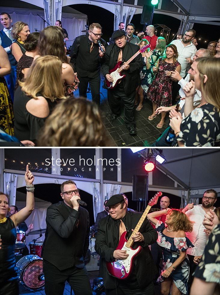 79_Guests circle around wedding band on dance floor.jpg